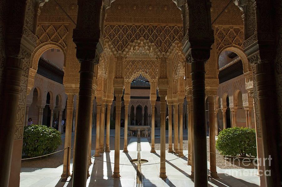 Tourists In The Courtyard In The Patio De Los Leones Area At Alhambra Photograph by Sami Sarkis