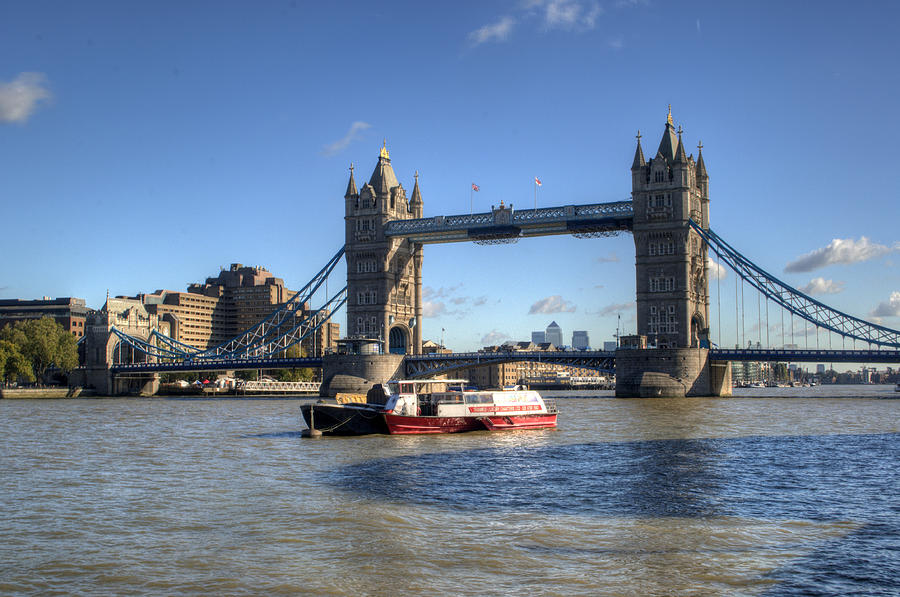 Tower Bridge Photograph - Tower Bridge With Canary Wharf In The Background by Chris Day