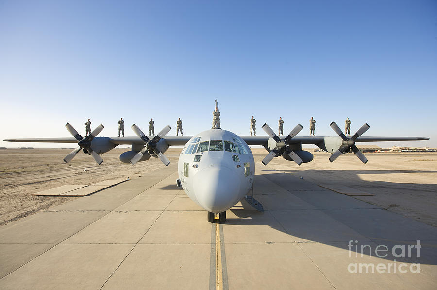 Air Force Photograph - Troops Stand On The Wings Of A C-130 by Terry Moore