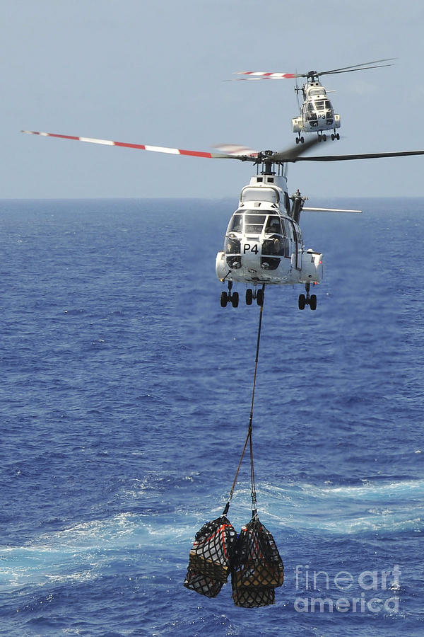 Replenishment At Sea Photograph - Two Sa-330 Puma Helicopters Deliver by Stocktrek Images