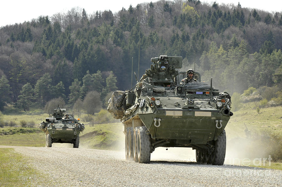 Stryker Photograph - Two Stryker Vehicles At The Hohenfels by Stocktrek Images