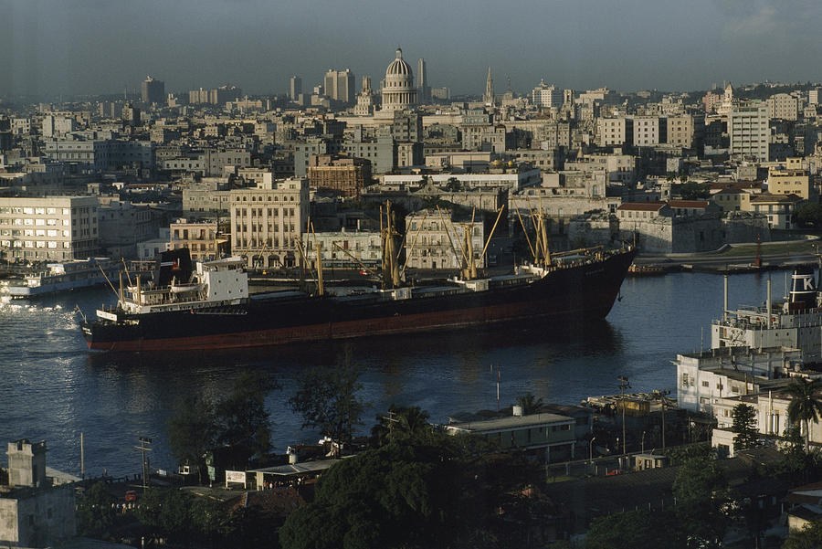 World Heritage Sites Photograph - View Of City And A Massive Freighter by James L. Stanfield
