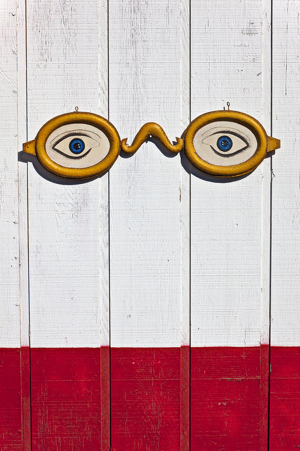 Vintage Eye Sign On Wooden Wall Photograph