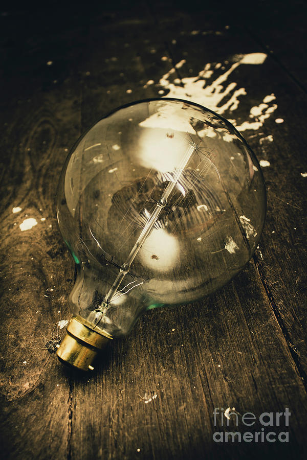 Vintage Light Bulb On Wooden Table Photograph