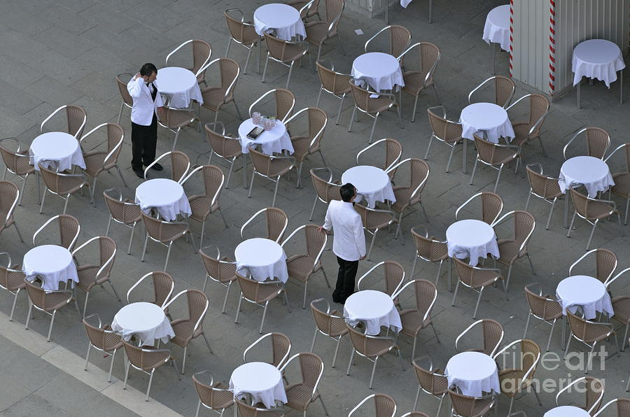 Venice Photograph - Waiters At Empty Cafe Terrace On Piazza San Marco by Sami Sarkis
