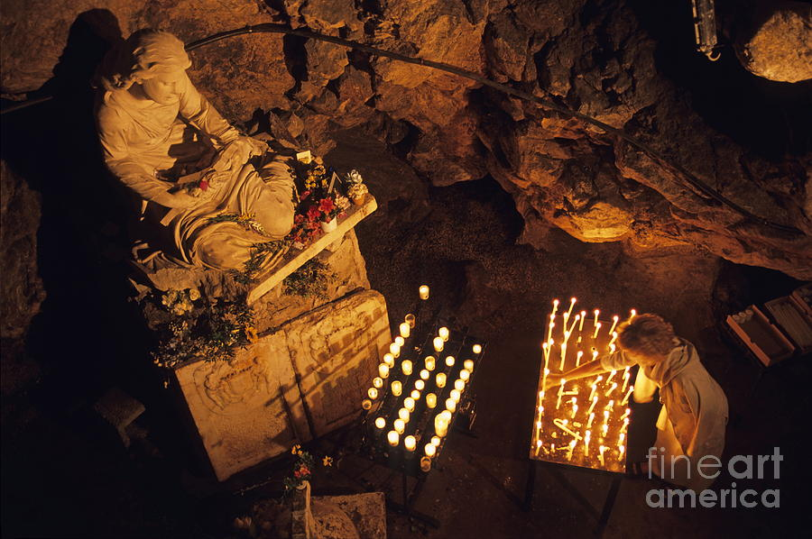 People Photograph - Woman Burning Candle At Troglodyte Sainte-marie Madeleine Holy Cave by Sami Sarkis