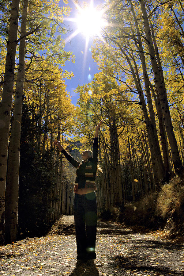 One Person Photograph - Woman In The Falling Leaves by Dawn Kish