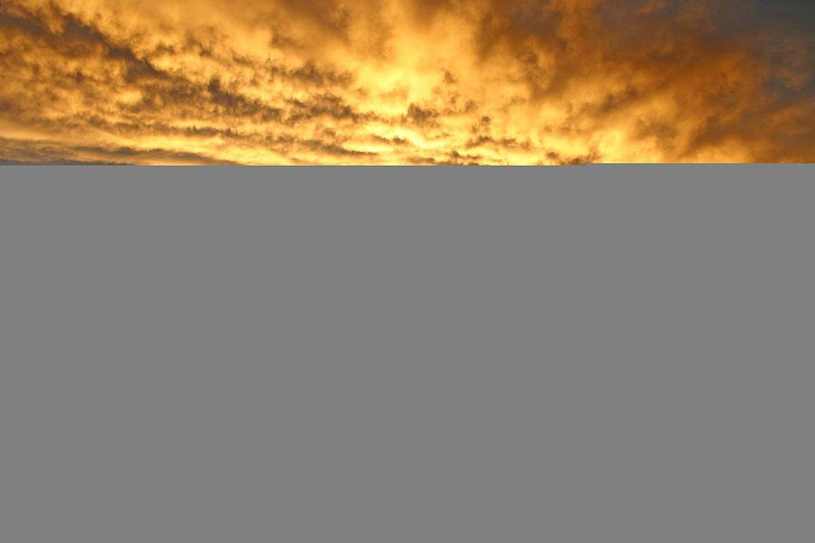 Woman Watching A Beautiful Sunset On Maui Hawaii Photograph