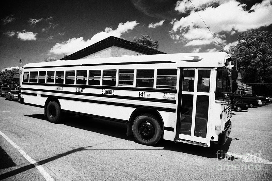 Yellow Photograph - yellow american bluebird school bus in Lynchburg tennessee usa by Joe Fox