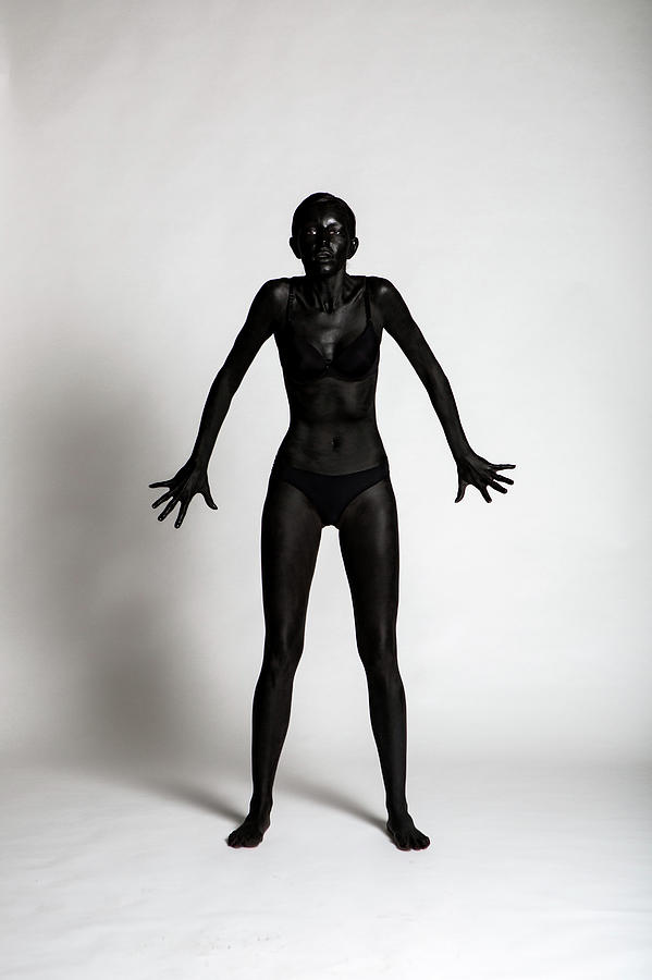 Girl Painted Black Paint Stand On A White Background Photograph
