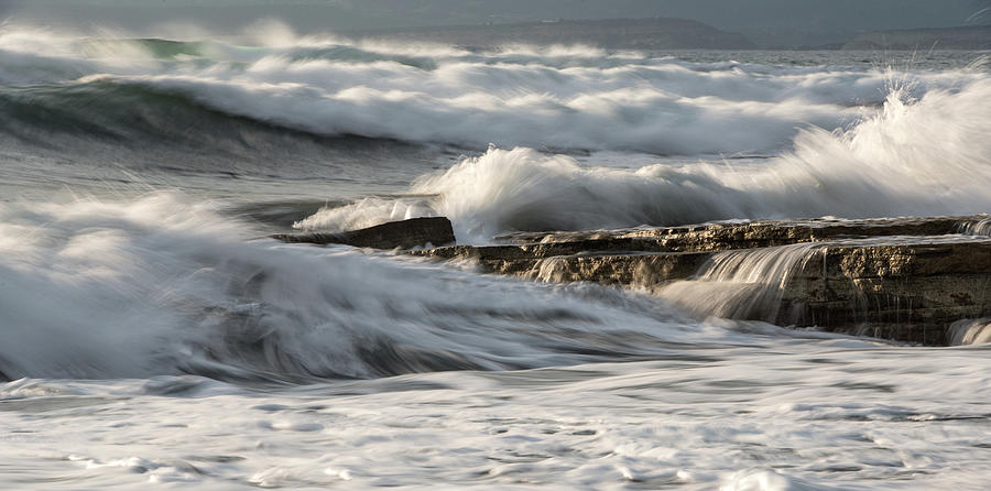 Rocky Seashore With Wavy Ocean And Waves Crashing On The Rocks Photograph