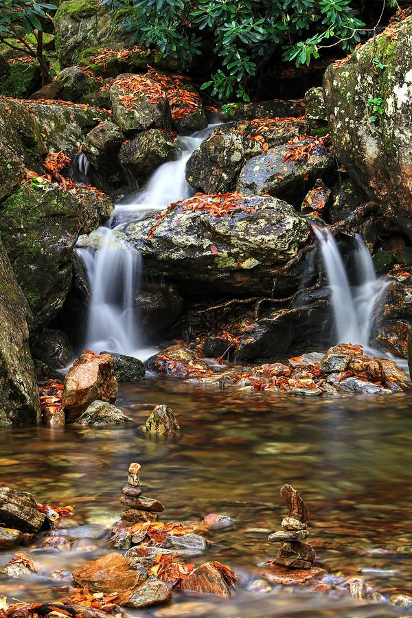 Cascades In Fall With Cairn Rocks Photograph