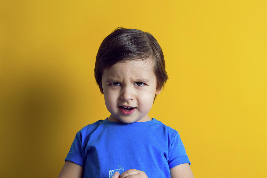 Cheerful Baby Boy In Blue T-shirt Stands Photograph