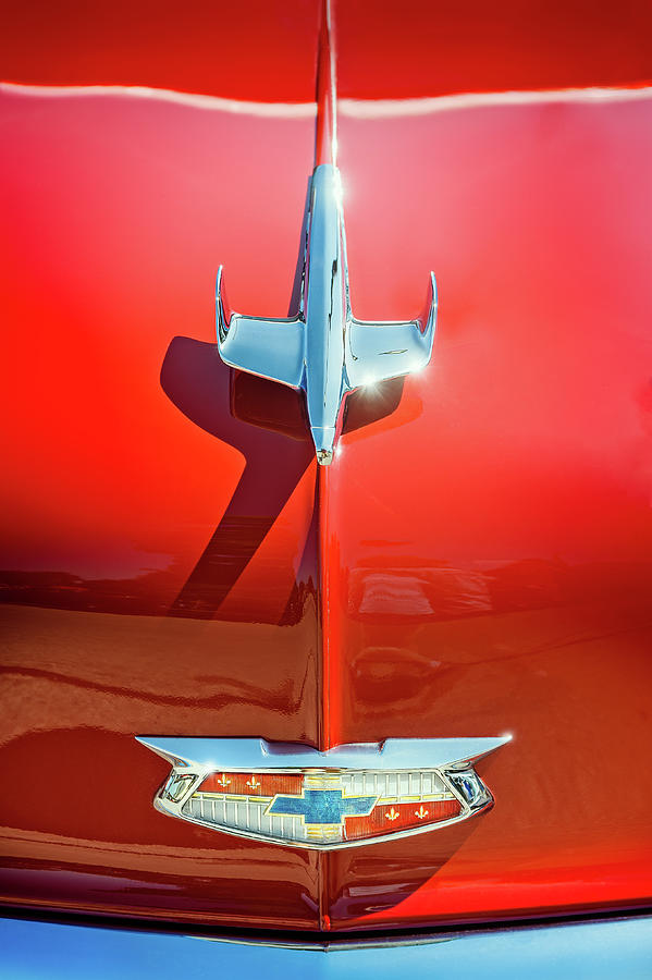 Hood Ornament On A Red 55 Chevy Photograph