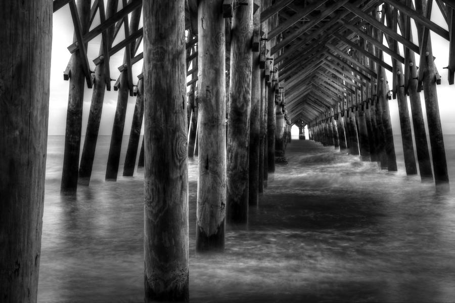 Pier Pilings In Black And White Photograph