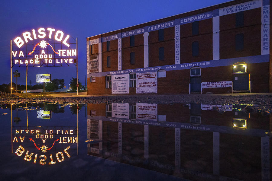 Reflections Of The Bristol Sign And Interstate Hardware Building Photograph