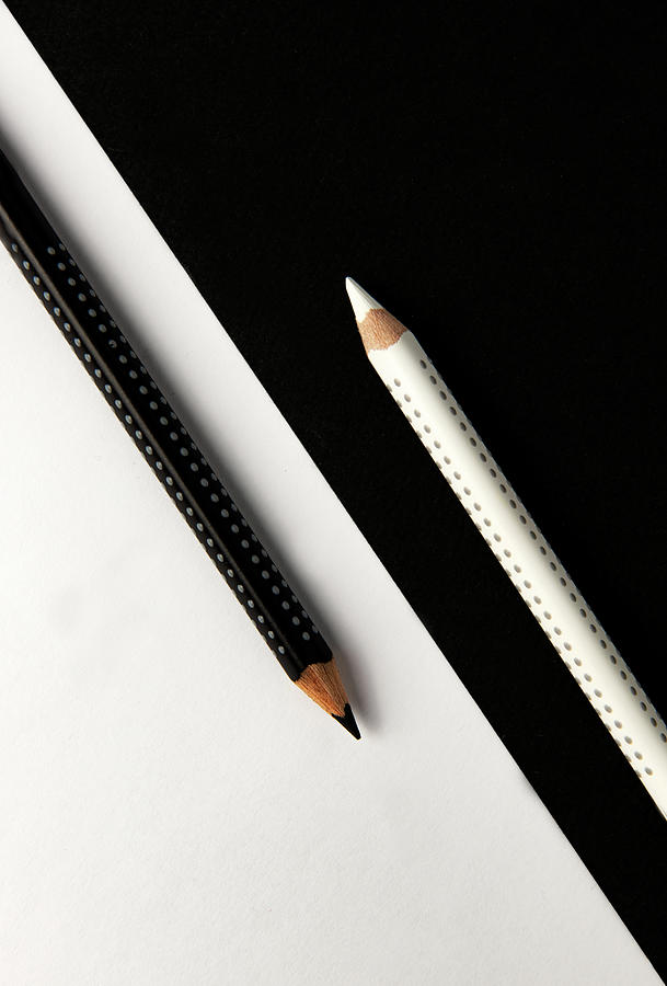 Two Drawing Pencils On A Black And White Surface. Photograph