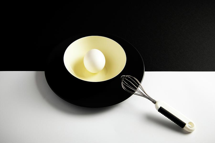 White Egg On A Yellow Bowl. Photograph