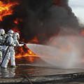 Firefighting Marines Battle A Huge by Stocktrek Images