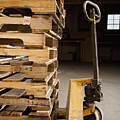 Hand Truck And Wooden Pallets by Shannon Fagan