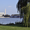 Lincoln Memorial And Washington Monument From The Potomac River by Brendan Reals