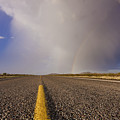 Storm And Rainbow Along The Highway by Jeremy Woodhouse