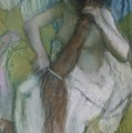 Woman Combing Her Hair by Edgar Degas