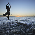 Female Doing Yoga At Sunset by Brandon Tabiolo - Printscapes