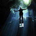 A Cavern Diver Ascends In The Cenote by Karen Doody