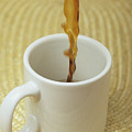 A Cup Of Energy Filled Coffee Is Poured by Taylor S. Kennedy