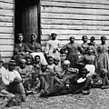 A Group Of Slaves by Photo Researchers