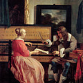 A Man And A Woman Seated By A Virginal by Gabriel Metsu