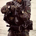 A Navy Seal Exits The Water Armed by Michael Wood