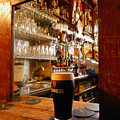 A Pint Of Dark Beer Sits In A Pub by Jim Richardson