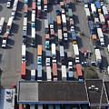 Aerial View Of Semi Trucks At Port by Don Mason