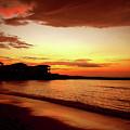 Alone On The Beach by Kamil Swiatek