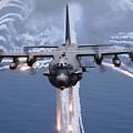An Ac-130h Gunship Aircraft Jettisons by Stocktrek Images