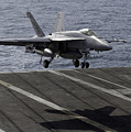 An Fa-18e Super Hornet Prepares To Land by Stocktrek Images