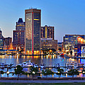 Baltimore Skyline Inner Harbor Panorama At Dusk by Jon Holiday