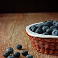 Blueberries In Wicker Basket by © Brigitte Smith