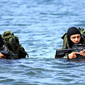 Buds Students Wade Ashore During An by Stocktrek Images