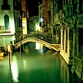 Canal And Bridge In Venice At Night by Michael Henderson