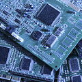 Computer Boards And Chips Lie In A Pile by Taylor S. Kennedy