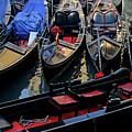 Empty Gondolas Floating On Narrow Canal In Venice by Sami Sarkis