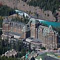 Fairmont Banff Springs Hotel With The Bow River Falls Banff Alberta Canada by George Oze