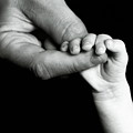 Father Holding Hand Of Baby by Sami Sarkis