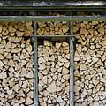 Firewood Stack by Frank Tschakert
