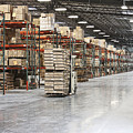 Forklift Moving Product In A Warehouse by Jetta Productions, Inc
