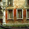 Gondola In Front Of House In Venice by Michael Henderson