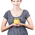 Holistic Naturopath Holding Jar Of Homemade Spread by Jorgo Photography - Wall Art Gallery